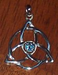 Celtic Triquetra with faceted blue topaz stone in claw setting by shadowsmith
