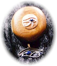 photo of Sterling Silver Eye of Horus pendant with Lapis Lazuli cabuchon and matching hand crafted Australian Black Bean wood, velvet lined jewellery box.  Features an Eye of Horus in copper and silver set with a Lapis Lazuli and silver knob on the lid