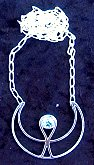 photo of Sterling silver Ankh Moon symbol set with faceted Light Blue Topaz stone on Sterling Silver chain. Chain is attached to each tip of the crescent moon.